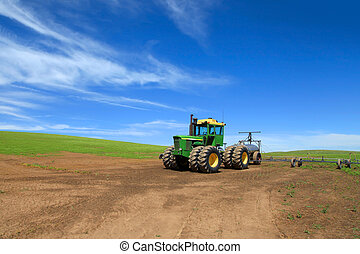 Farm equipment in the middle of fields