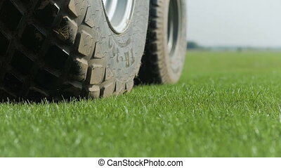 Farm Fetilizer Wheel In The Green Lawn Field
