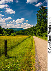 Farm field along a road in the rural Potomac Highlands of...
