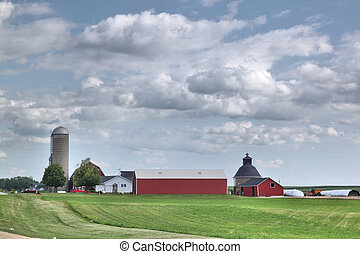 Farm field farm buildings and silo - A modern farm with old...