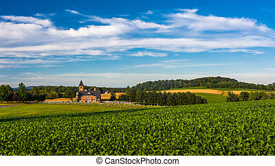 Farm fields and view of a church in rural York County, Pennsylvania.