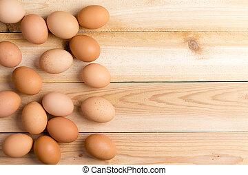Farm fresh brown eggs on a wooden table