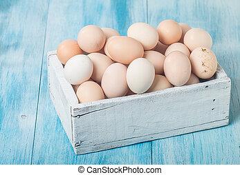 Farm fresh chicken eggs in box