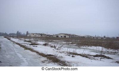 Farm from far away in winter
