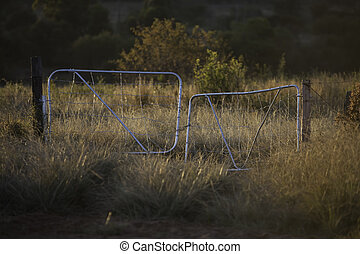Farm Gate - An old style typical African farm gate sunlit in...