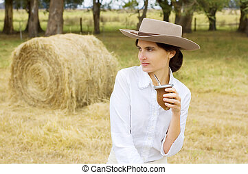 Farm Girl Relaxing - A typical Argentinean gaucha (cowgirl) ...