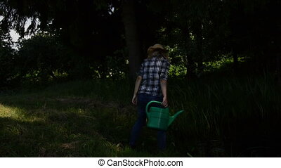 farm girl watering-can - Farm girl draw water from pond and...