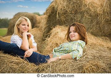 Farm girls on  hay