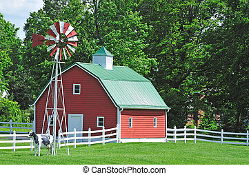 farm house in the usa with windmill and white fence