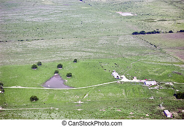 Farm land. - Aerial view of a small farm in a very rural ...