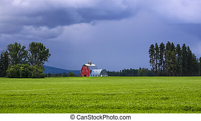 Farm landscape in Montana with storm clouds