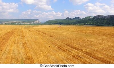 Farm Machinery In The Field Harvesting Wheat - AERIAL VIEW....