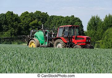 farm machinery tractor long sprayer work in field