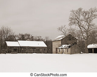 An old fashioned sepia-toned image of an old farm scene in Winter.