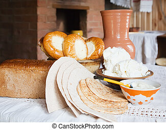 farm-style meal on table in rural house interior