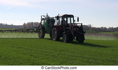 farm tractor spray autumn season green crop field