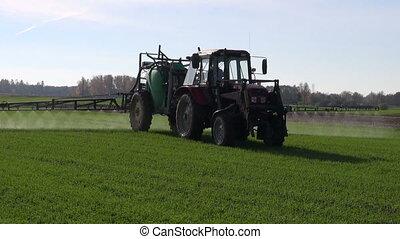 farm tractor spray crop field - farm tractor spray autumn...