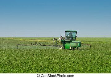 Farm Tractor Sprayer In Field - Farm tractor with sprayer...