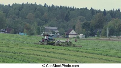 farm truck truck mowing grass on a meadow in the autumn...