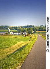 View of a farm under a blue sky