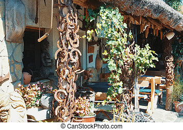 Farm village background, a hungarian vintage retro house decorated with plants, ivy and old rusty metal horseshoes.