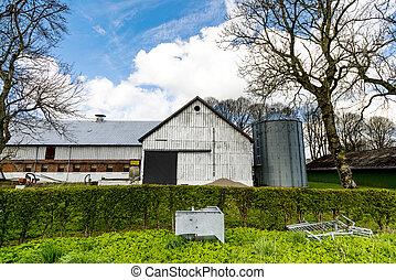 Farm with a silo and a large barn