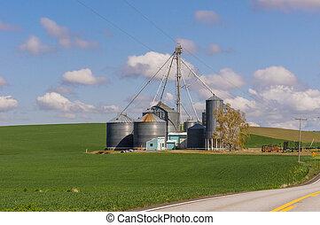 Farm with grain storage silos