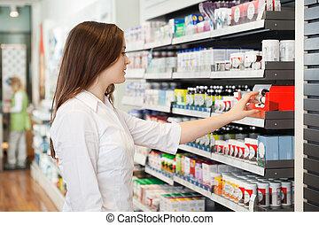 farmacéutico, joven, hembra