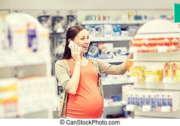 farmacia, smartphone, mujer felíz, embarazada