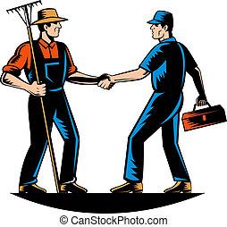 farmer and a tradesman,repairman,plumber or handyman shaking...