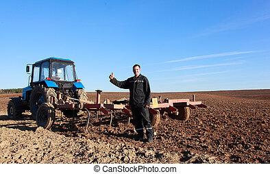 Farmer at work - A farmer prepare his fields for spring ...