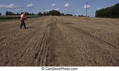 Farmer checking straw field