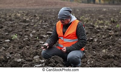Farmer checking the plowed field