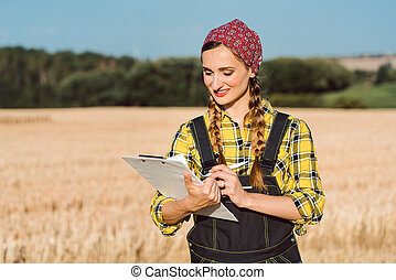 Farmer doing business administration on the field