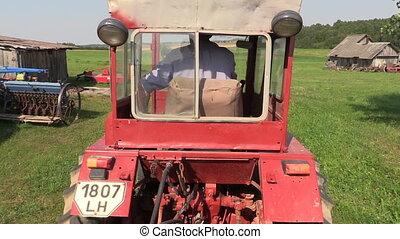 farmer drive red tractor