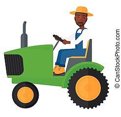 Farmer driving tractor. - An african-american farmer driving...