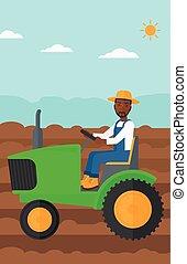 Farmer driving tractor.