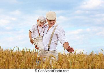 farmer family on wheat field