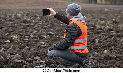 Farmer filmed the plowed field