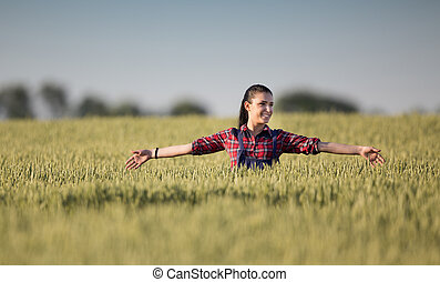 Farmer girl in barley field - Pretty young farmer woman...