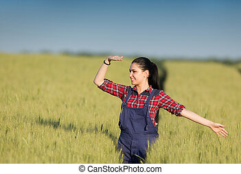 Farmer girl in wheat field