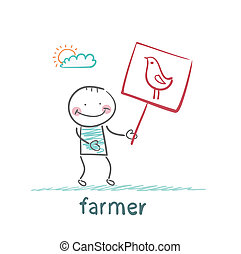 farmer holding a poster with chicken