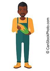 Farmer holding corn. - An african-american agriculturist...