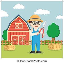 farmer holding pruning scissor
