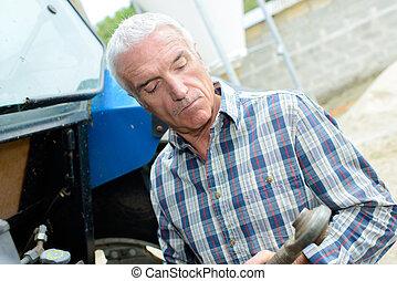 Farmer holding tractor pto shaft