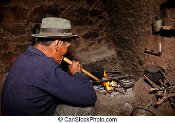 Farmer In A Hut On A Fireplace, Andes in Peru, South America