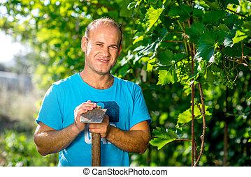 Farmer in the grape plantation - Portrait of the farmer with...