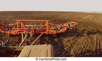 Farmer in tractor plows Russia steadicam motion agriculture...