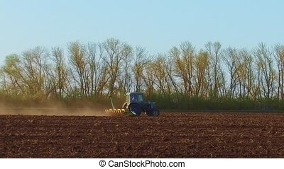 Farmer in tractor plows steadicam slow motion Russia...