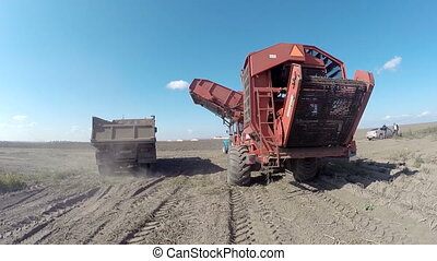 Farmer in tractor preparing land